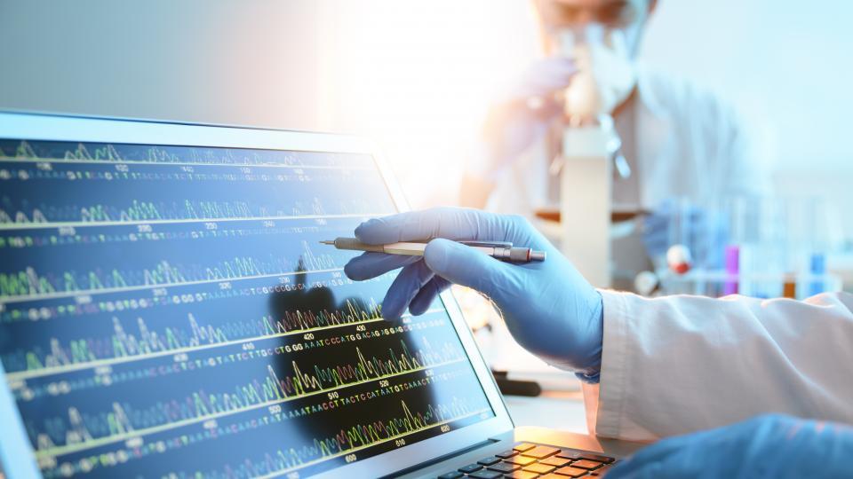 A biomedical scientist monitoring health data
